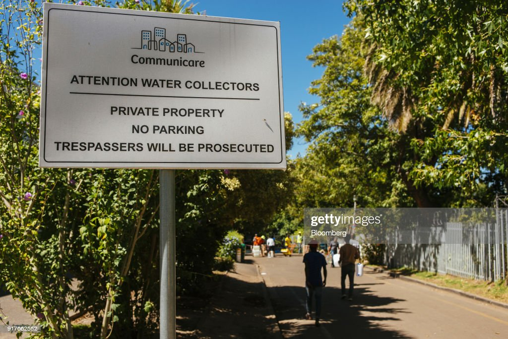 A road sign which reads 'Attention Water Collectors' stands