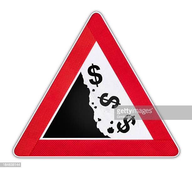 Road Sign with falling dollar currency symbols.