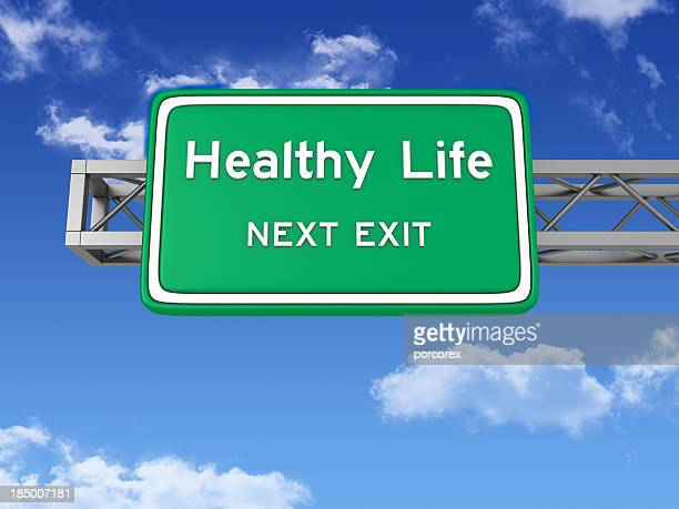 Road Sign with HEALTHY LIFE and Sky