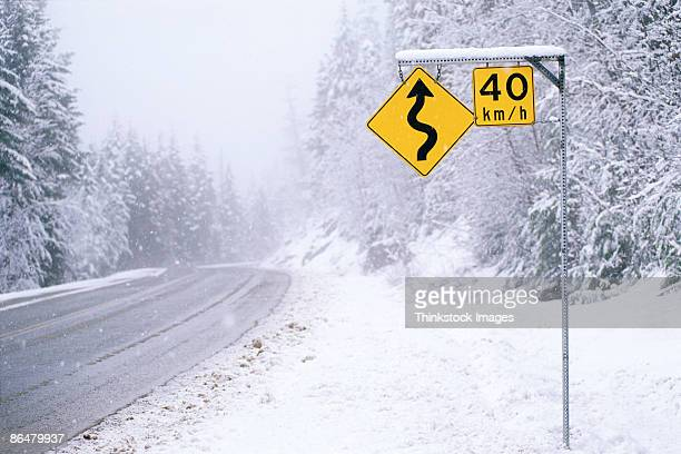 Road sign with speed limit in snow