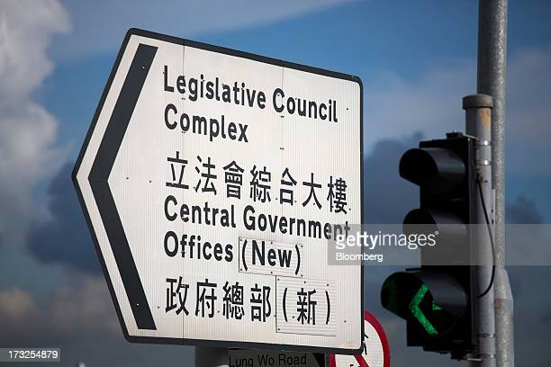 Road signage for directions to the Legislative Council Complex and Central Government Offices is displayed near the Central Government Complex in...