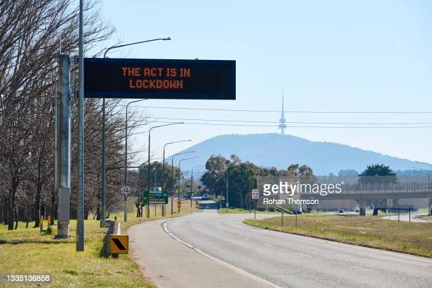 Road signage saying 'THE ACT IS IN LOCKDOWN' over Adelaide Avenue on August 20, 2021 in Canberra, Australia. Lockdown restrictions continue in...