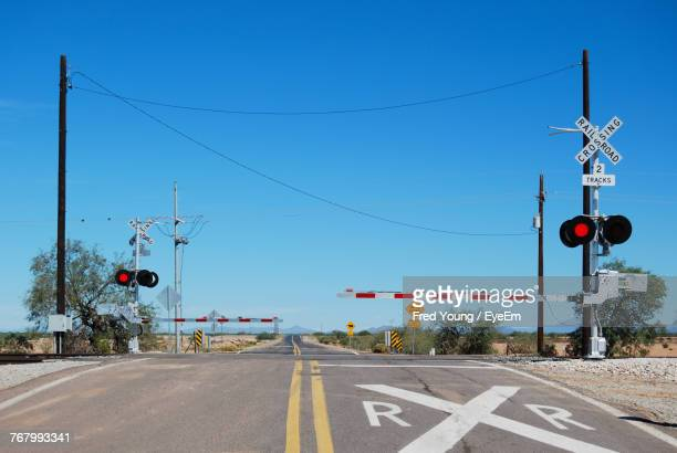 road signs against clear blue sky - railroad crossing stock pictures, royalty-free photos & images