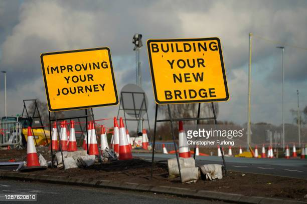 Road signs and traffic cones stand by roadworks and junction improvements at Junction 19 of the M6 motorway on November 25, 2020 in Knutsford,...