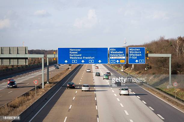 Road signs and traffic on german Autobahn A5