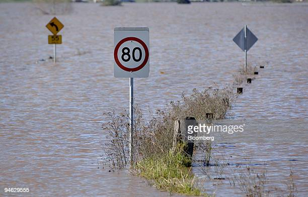 Road signs are submerged in flood waters following a storm in the town of Maitland north of Sydney Australia on Wednesday June 13 2007 The fourday...