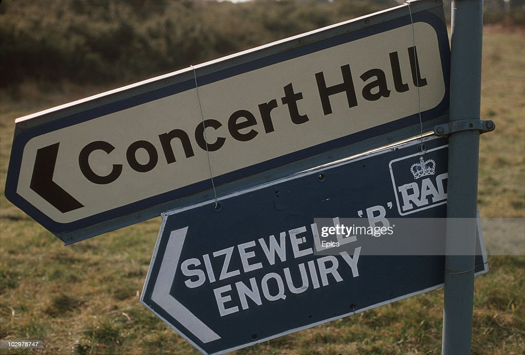 Road signs giving directions to the concert hall and the Sizewell 'B' enquiry at Snape, Suffolk, circa 1984. The public enquiry into the construction of Sizewell 'B' nuclear power station lasted from 1982 to 1985.