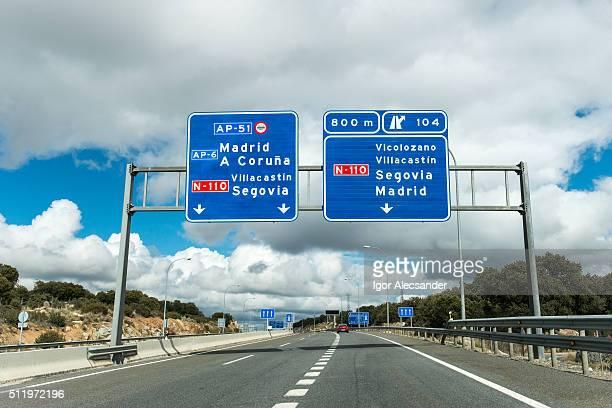 Road signs in Autopista A-6 highway, Avila, Spain