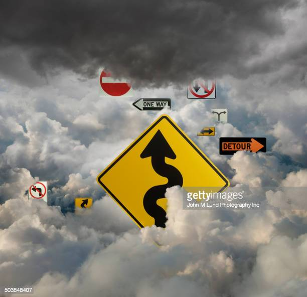 road signs in cloudy sky - detour sign stock photos and pictures