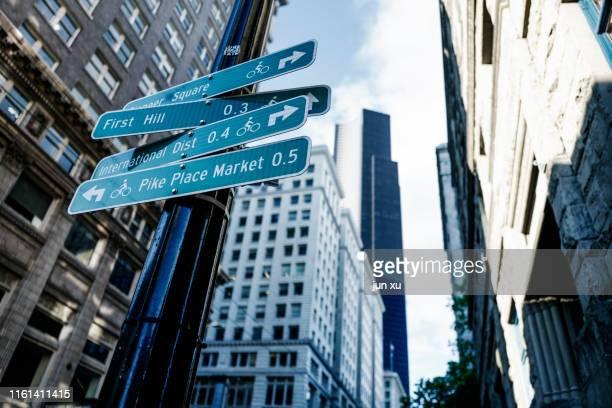 road signs in modern cities - seattle imagens e fotografias de stock