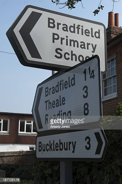 Road Signs In The Village Of Bradfield Next To Bucklebury, Berkshire, United Kingdom.