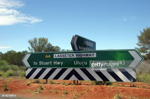 Road signs on the T-intersection of Lasseter Highway with Luritja Road, Northern Territory, Australia