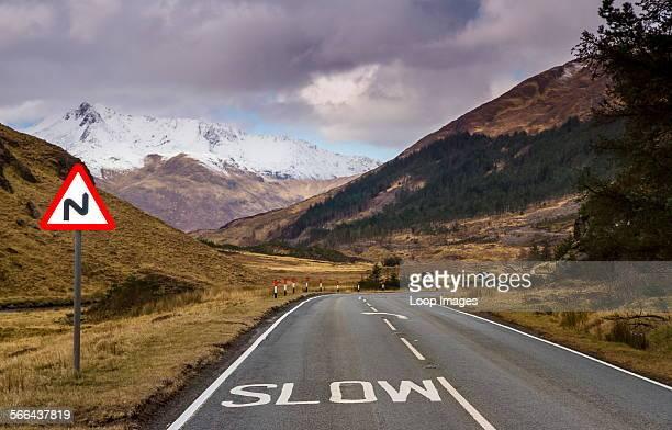 Road signs on the twisting road through Glen Shiel