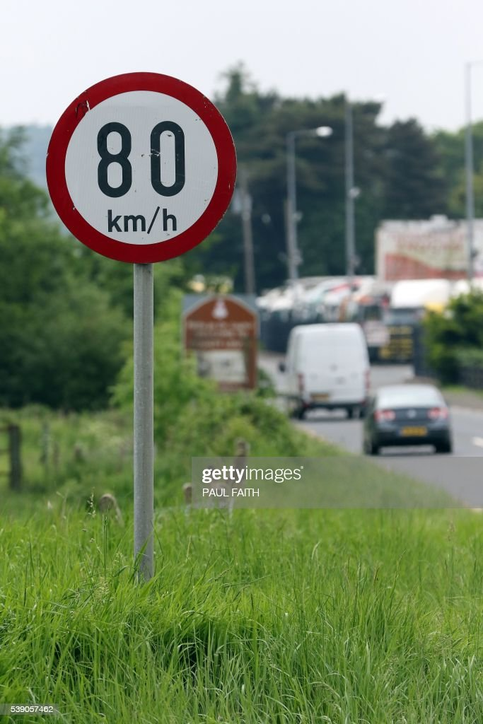 Road speed sign changes to Kilometres per hour, between Newry in Northern ireland and Dundalk in The Republic of Ireland on June 7, 2016. The border that divides the island of Ireland is now invisible, with just a few crumbling former customs buildings serving as reminders of a bygone era of a hard frontier between north and south. All of this could be about to change. In the event of a Brexit on June 23, these 500 kilometres (311 miles) would become the sole land border between the United Kingdom and the European Union and there are genuine concerns that this will mean the reintroduction of customs barriers that were abolished on January 1, 1993 - and even immigration controls for the first time. /
