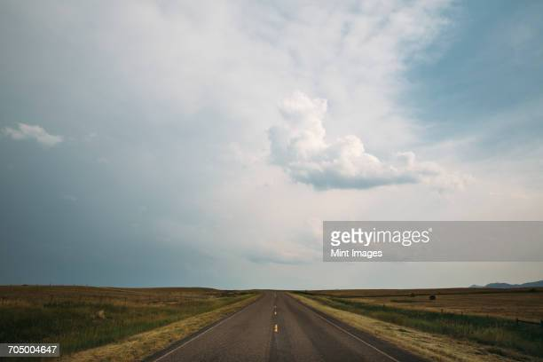 A road stretching to the horizon in a flat landscape.