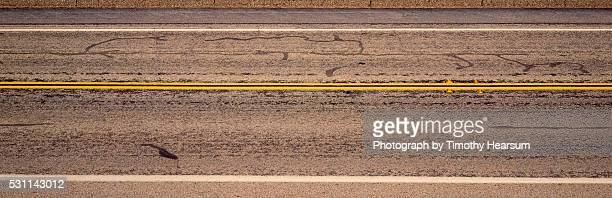 road surface with yellow stripes - timothy hearsum ストックフォトと画像