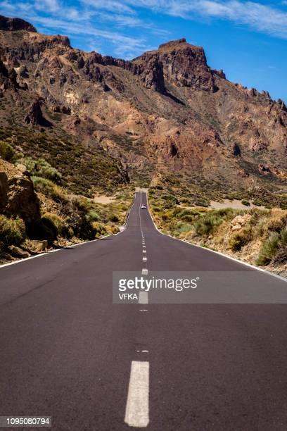 road tf-21 leading through llano de ucanca, teide national park (parque nacional del teide), tenerife, canary islands, spain - el teide national park stock pictures, royalty-free photos & images