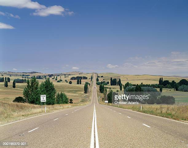 road through countryside, australia - two lane highway stock pictures, royalty-free photos & images