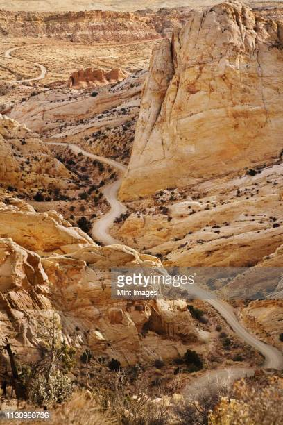 road through craggy desert - capitol reef national park stock pictures, royalty-free photos & images