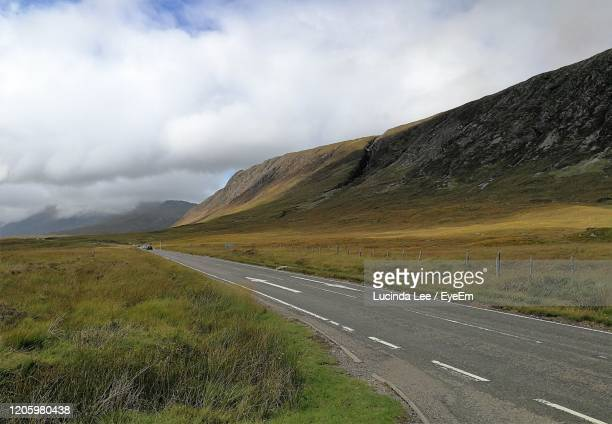 road through mountains in glencoe - lucinda lee stock pictures, royalty-free photos & images