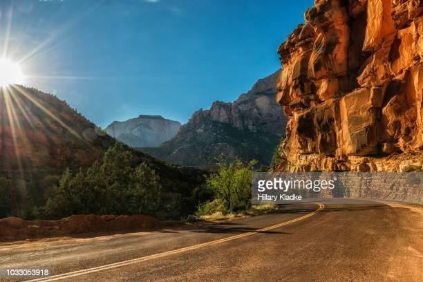 road through mountains in utah - canyon stock-fotos und bilder