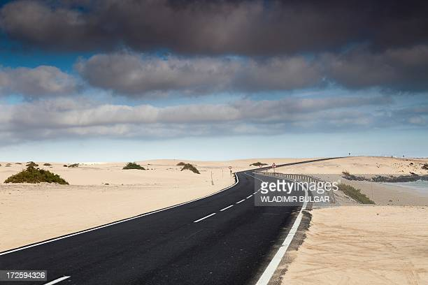 Road through sand dunes, Canary Islands