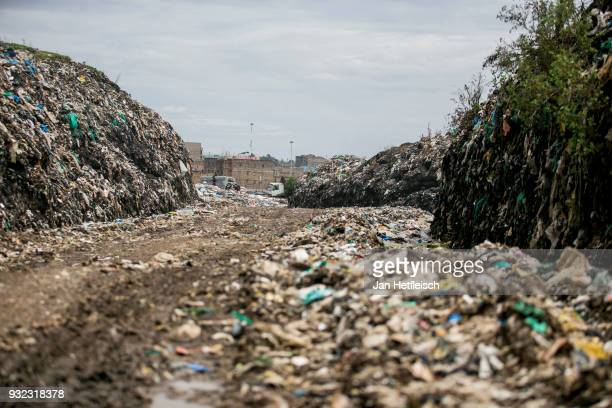 A road through the Dandora rubbish dump on March 14 2018 in Nairobi Kenya The Dandora landfield is located 8 Kilometer east of the city center of...