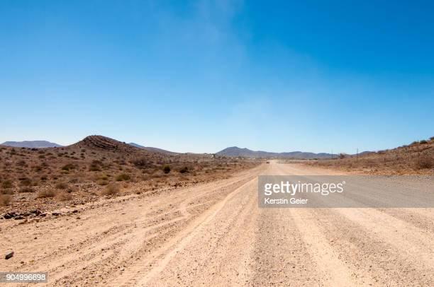 road through the desert. erongo conservancy, namibia - erongo stock photos and pictures