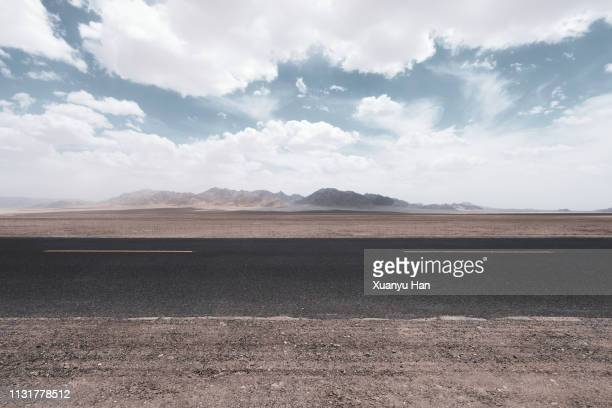 road through the desert - gobi desert stock pictures, royalty-free photos & images