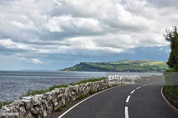 road to carnlough  in county antrim, northern ireland - county antrim stock pictures, royalty-free photos & images