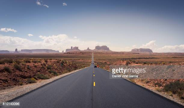 road to monument valley - road trip stock photos and pictures