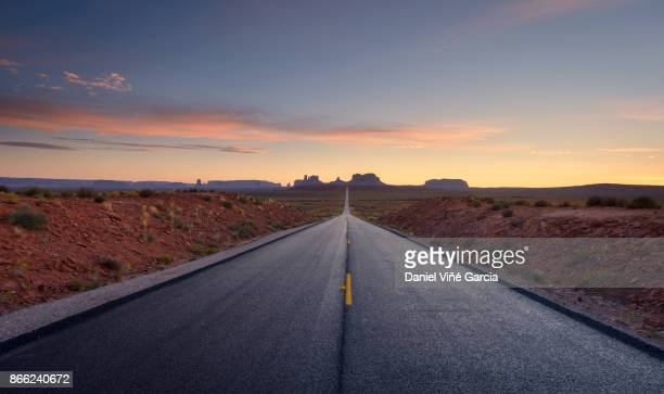 road to monument valley tribal park - thoroughfare stock photos and pictures