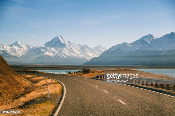 road to mount cook - taking a corner stock pictures, royalty-free photos & images