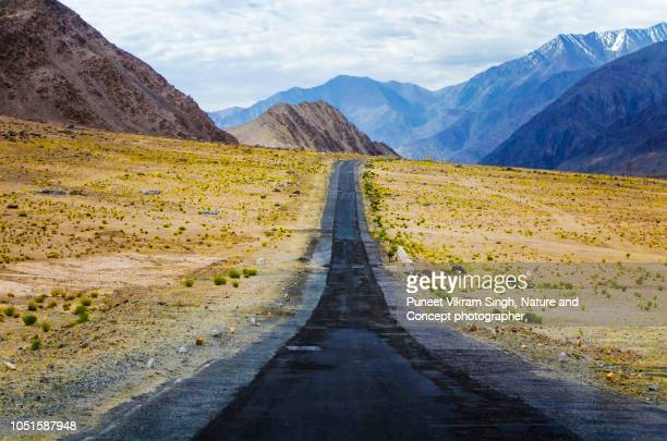 Road to mountains in diminishing perspective in Leh, Ladakh.