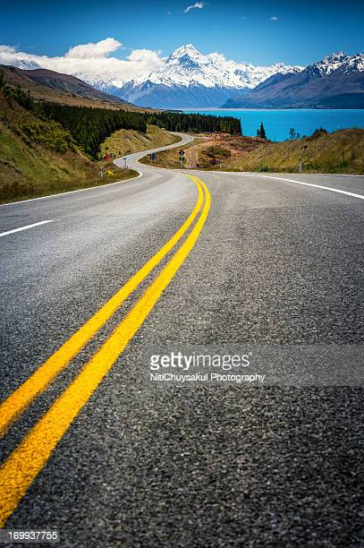 road to mt. cook new zealand - double yellow line stock photos and pictures