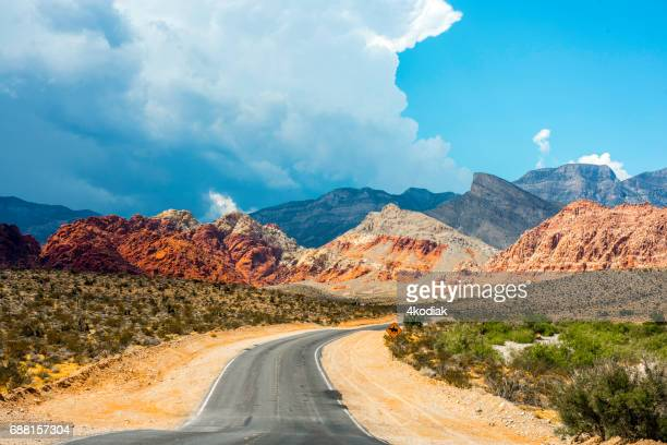 road to red rock canyon - red_rock,_nevada stock pictures, royalty-free photos & images