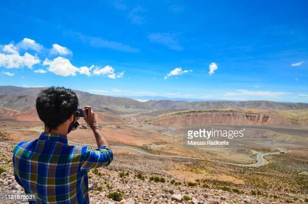 road to salinas grandes, salta province, argentina - radicella stockfoto's en -beelden