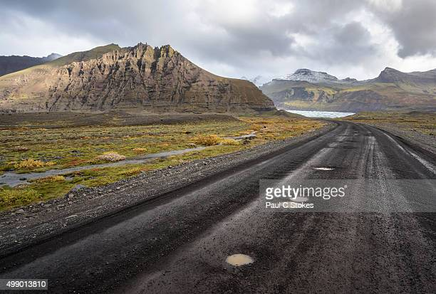 road to svínafellsjökull glacier - waterhole stock pictures, royalty-free photos & images