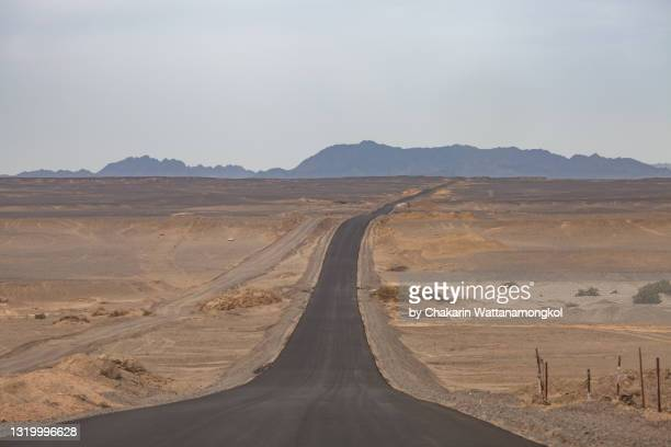 road to the devil's city - yadan landform (dunhuang yadan national geopark) in gobi desert. - mid section stock pictures, royalty-free photos & images