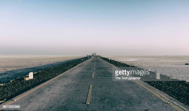 road to the horizon - the storygrapher stock pictures, royalty-free photos & images