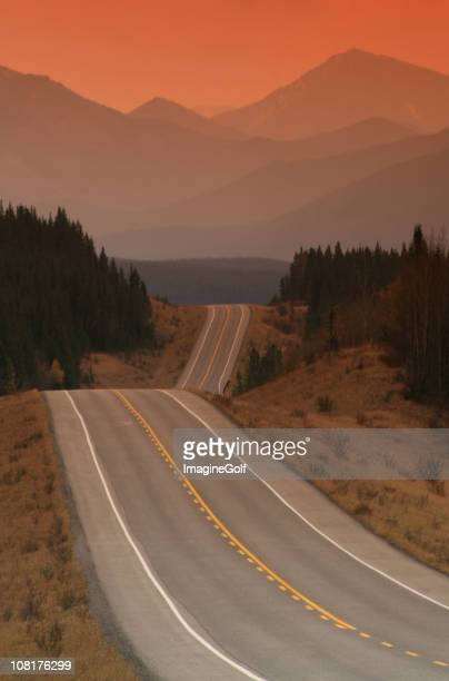 road to the mountains at sunset - kananaskis country stock pictures, royalty-free photos & images