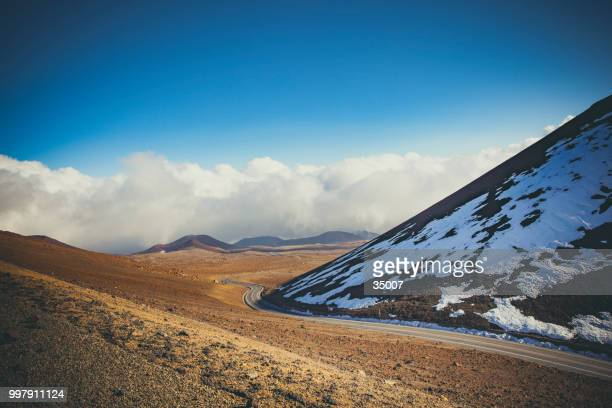 road to the top of mauna kea volcano snow capped, big island hawaii - tropical bird stock pictures, royalty-free photos & images