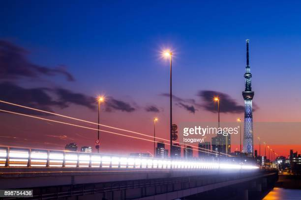 a road to tokyo skytree at twilight - isogawyi stock pictures, royalty-free photos & images
