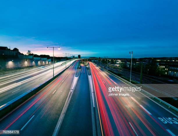 Road traffic at dusk