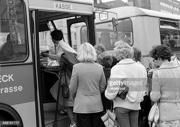 road traffic bus stop passengers board a bus DOberhausen DOberhausenSterkrade Ruhr area North RhineWestphalia