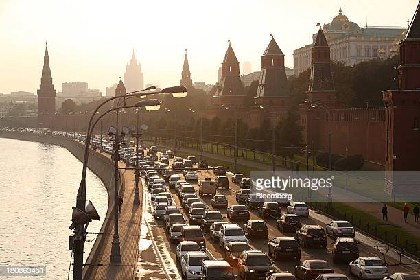 Road traffic forms congestion on a highway beside the Moskva river and Kremlin right in the early evening in Moscow Russia on Thursday Sept 12 2013...