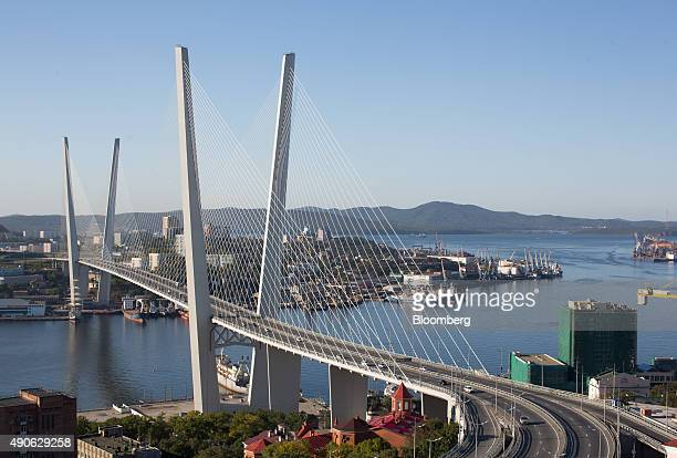 Road traffic passes across a waterway on Golden bridge in Vladivostok Russia on Sunday Sept 27 2015 'It is simply impossible to predict how global...