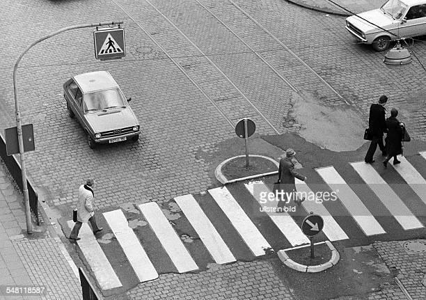 road traffic people cross the street on a cebra crossing waiting cars DOberhausen DOberhausenSterkrade Ruhrgebiet North RhineWestphalia