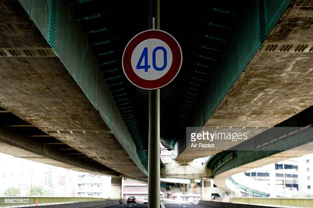 road traffic sign of road under highway - number 40 stock photos and pictures