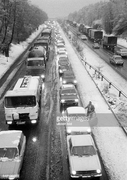 road traffic traffic jam on the motorway A2 near Oberhausen twilight winter snow slush cars drive on dimmed headlights DOberhausen...